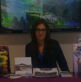 Ana Moreno, responsable de turismo del Parque de las Ciencias  en el Stand de Andalucía